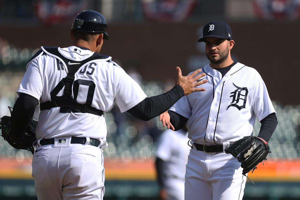 Detroit Tigers pitcher Bryan Garcia celebrates a 5-2 win over the Cleveland Indians with catcher Wilson Ramos at Comerica Park on April 3, 2021.