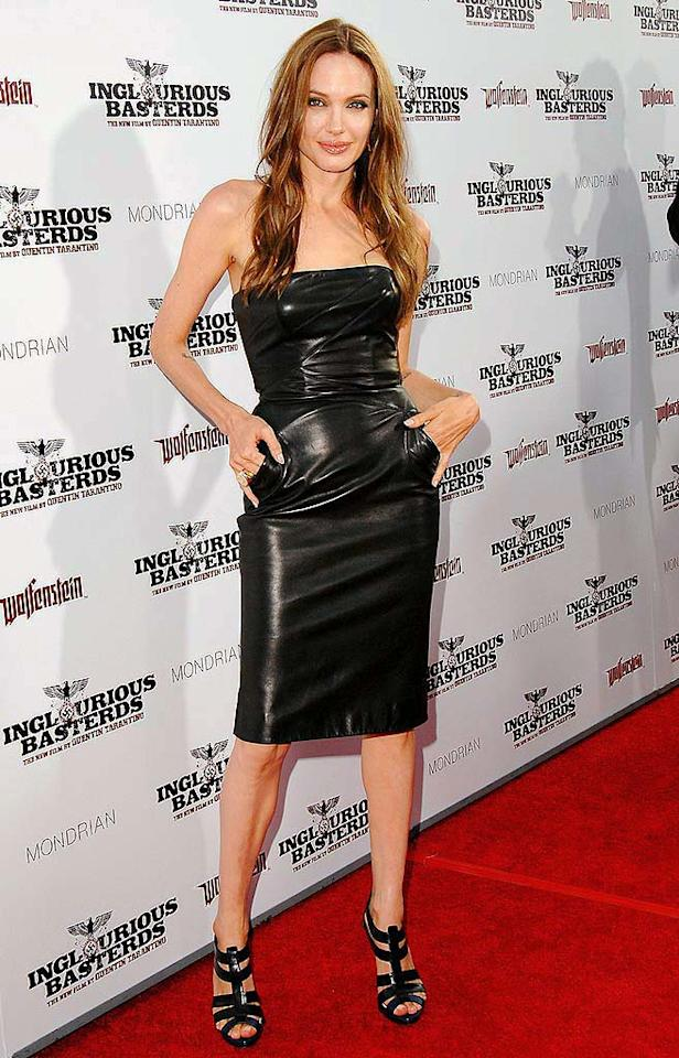 "August: Angelina Jolie   Following an extended absence on the red carpet, the A-list actress made a triumphant return at the premiere of her man Brad Pitt's latest hit, ""Inglourious Basterds,"" in a black strapless leather dress courtesy of Michael Kors. Jon Kopaloff/<a href=""http://filmmagic.com/"" target=""new"">FilmMagic.com</a> - August 10, 2009"