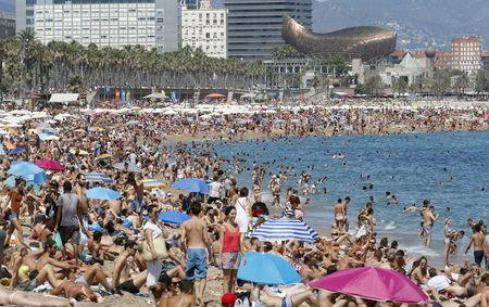 People Cool Off At Sant Sebastia And Miquel Beaches In Barceloneta Neighborhood Barcelona