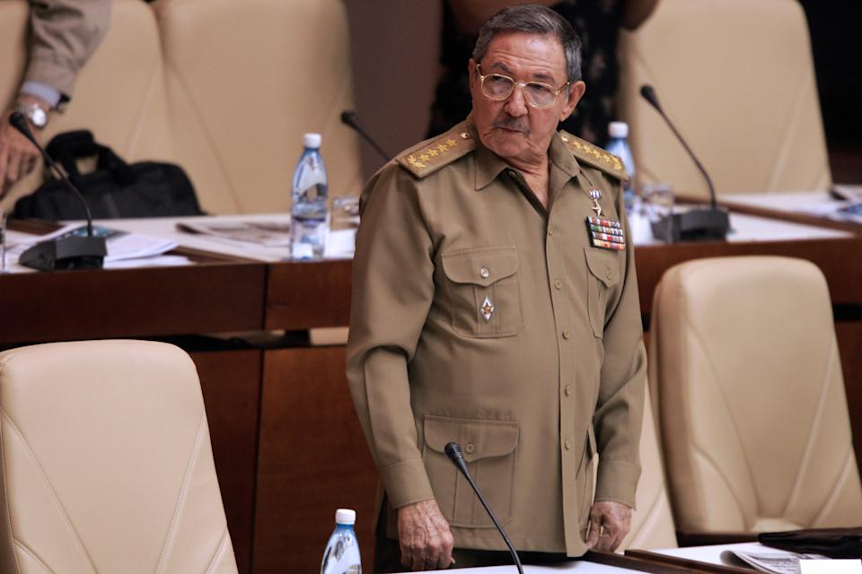 HAVANA, CUBA: Cuban interim leader Raul castro stands during the Cuban National Assembly in its second annual session 22 December, 2006 in Havana. Cuba's National Assembly speaker Ricardo Alarcon opened the body's key annual session Friday with no mention whatsoever of ailing Cuban leader Fidel Castro, who did not attend. Amid uncertainty over the health of the 80-year-old Castro, there was an empty seat where he normally sits. The Cuban leader has missed just one other gathering of the assembly in three decades. Castro ceded power officially, but temporarily, on July 31 to his brother Raul Castro, 75, the defense chief. Fidel Castro underwent surgery in July after intestinal bleeding. AFP PHOTO/ADALBERTO ROQUE (Photo credit should read ADALBERTO ROQUE/AFP via Getty Images)
