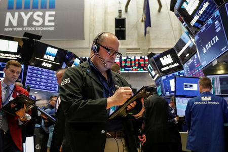 Traders work on the floor of the NYSE in New York