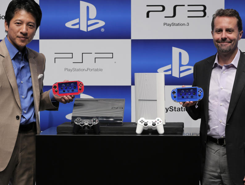 Sony Computer Entertainment Inc. President and CEO, Andrew House, right, and Sony Computer Entertainment Japan President Hiroshi Kawano show the new PlayStation 3 and PS VITA during a news conference in Tokyo, Wednesday, Sept. 19, 2012. Sony Corp. is introducing a smaller, slimmer and lighter version of its PlayStation 3 home console ahead of the year-end holidays as it gears up for growing competition in games from smartphones. (AP Photo/Itsuo Inouye)