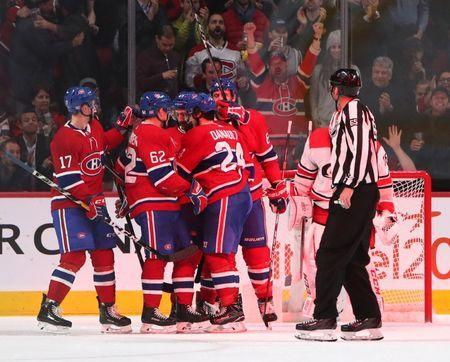 Nov 27, 2018; Montreal, Quebec, CAN; Montreal Canadiens center Phillip Danault (24) celebrates his goal against Carolina Hurricanes goaltender Curtis McElhinney (35) with teammates during the third period at Bell Centre. Mandatory Credit: Jean-Yves Ahern-USA TODAY Sports