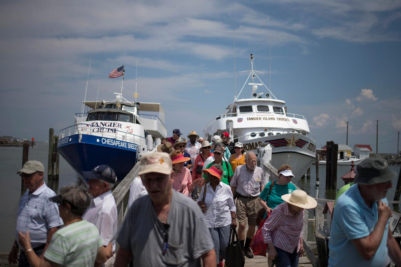 <p>Tourists arrive by ferry to Tangier Island, Virginia, Aug. 2, 2017. (Photo: Adrees Latif/Reuters) </p>