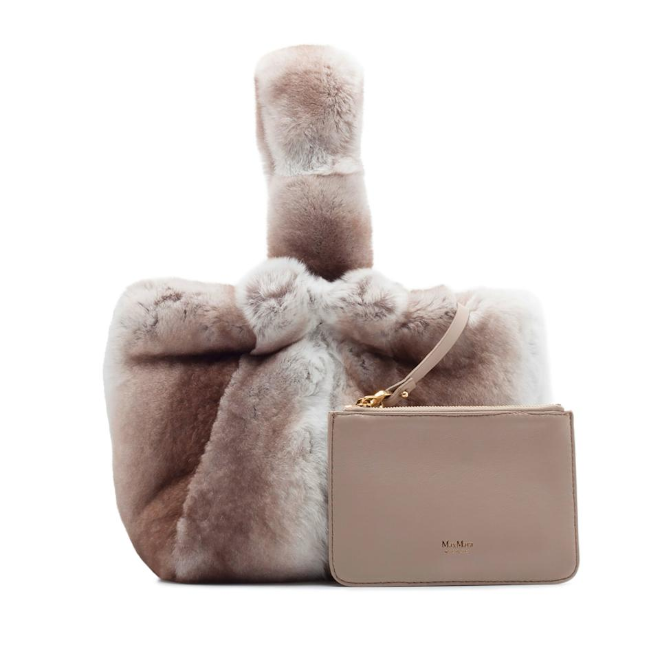 """<p>While the gift of a classic Max Mara coat would be a welcome gift, this furry bag with handle is the way to go for the woman who loves a little flair.</p> <p><strong>Buy now:</strong> Max Mara bag, $1,935, <a rel=""""nofollow"""" href=""""https://world.maxmara.com/p-4516148706018-anit6s-light-grey%7B:target=_blank%7D%7B:%20rel=nofollow%7D"""">maxmara.com</a>.</p>"""
