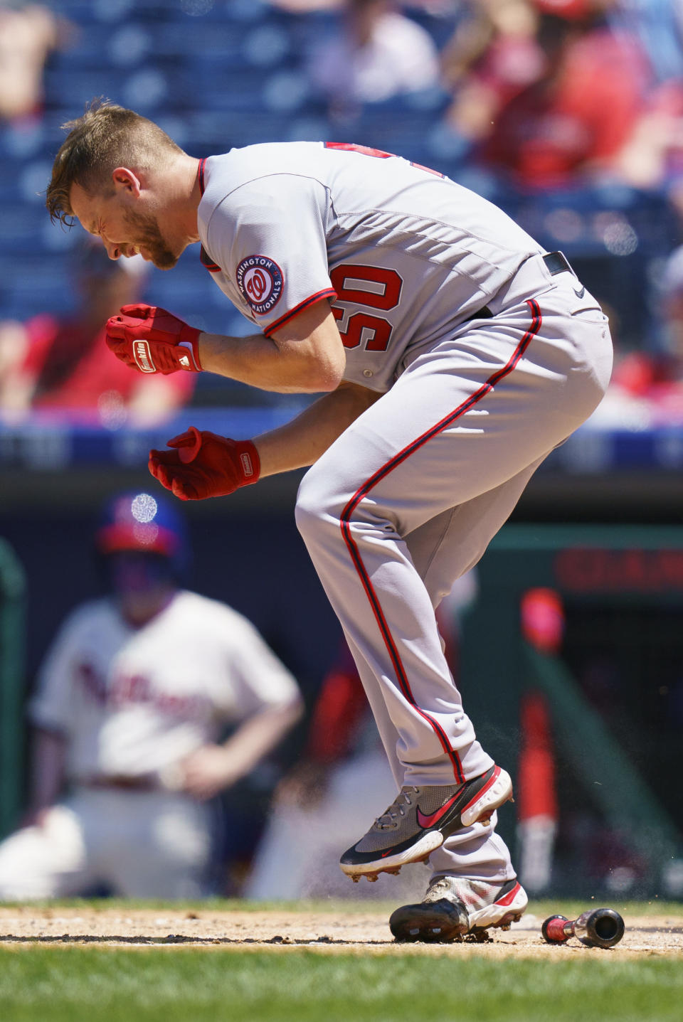 Washington Nationals' Austin Voth reacts after getting hit in the face by a pitch during the third inning of a baseball game against the Philadelphia Phillies, Sunday, June 6, 2021, in Philadelphia. (AP Photo/Chris Szagola)