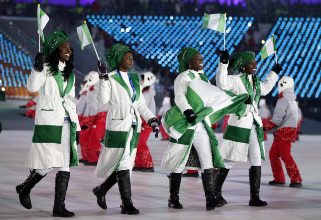 <p>Nigerian team members walk into the arena during the opening ceremony of the 2018 Winter Olympics in Pyeongchang, South Korea, Friday, Feb. 9, 2018. (AP Photo/Jae C. Hong) </p>