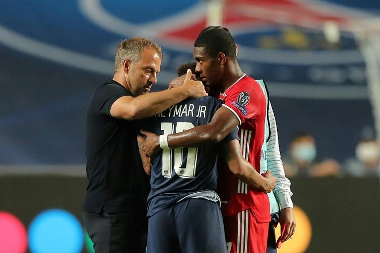 Bayern Munich coach Hans-Dieter Flick (L) and defender David Alaba (R) console Paris Saint-Germain star Neymar after the German club won the Champions League final in August