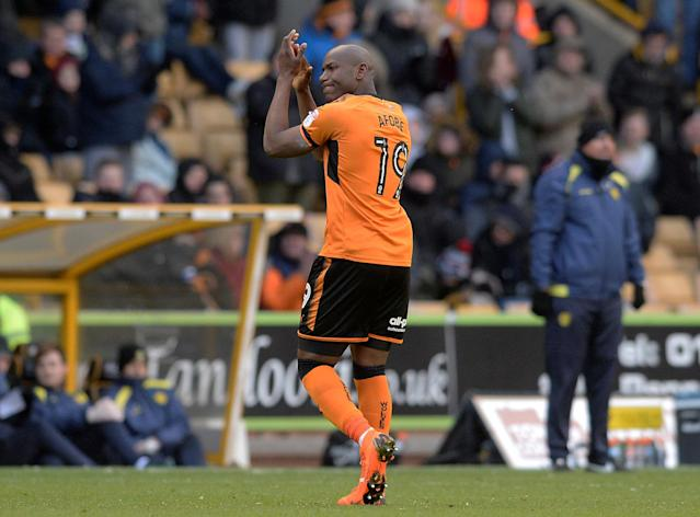 "Soccer Football - Championship - Wolverhampton Wanderers vs Burton Albion - Molineux Stadium, Wolverhampton, Britain - March 17, 2018 Wolves' Benik Afobe applauds the fans as he leaves the pitch Action Images/Alan Walter EDITORIAL USE ONLY. No use with unauthorized audio, video, data, fixture lists, club/league logos or ""live"" services. Online in-match use limited to 75 images, no video emulation. No use in betting, games or single club/league/player publications. Please contact your account representative for further details."