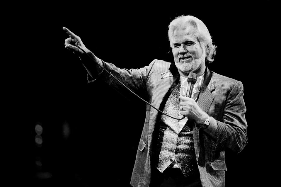American Country musician Kenny Rogers (1938 - 2020) performs onstage at Brendan Byrne Arena (later Meadowlands Arena), East Rutherford, New Jersey, October 20, 1988. (Photo: Gary Gershoff/Getty Images)
