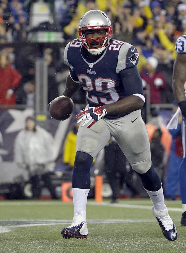 New England Patriots running back LeGarrette Blount runs through the end zone after scoring a touchdown during the first half of an AFC divisional NFL playoff football game against the Indianapolis Colts in Foxborough, Mass., Saturday, Jan. 11, 2014. (AP Photo/Matt Slocum)