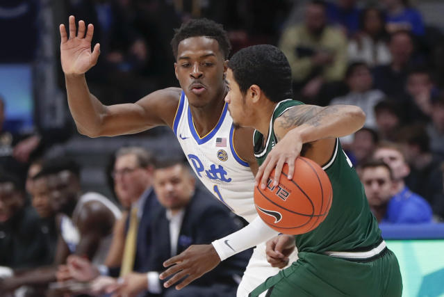 Pittsburgh's Xavier Johnson, left, defends against Binghamton's Sam Sessoms who takes the ball downcourt during the first half of an NCAA college basketball game, Friday, Dec. 20, 2019, in Pittsburgh. (AP Photo/Keith Srakocic)