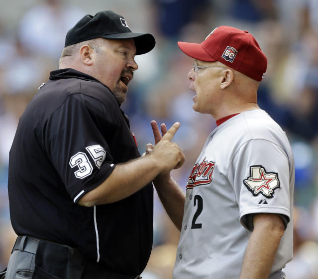 File-This Aug. 1, 2012 file photo shows Houston Astros manager Brad Mills, right, arguing with home plate umpire Wally Bell during the eighth inning of a baseball game against the Milwaukee Brewers in Milwaukee. Bell, who worked the NL playoff series between the Pittsburgh Pirates and St. Louis Cardinals this month, has died. He was 48. Major League Baseball confirmed Bell's death Monday Oct. 14, 2013. He died of an apparent heart attack in his home state of Ohio. (AP Photo/Jeffrey Phelps, File)