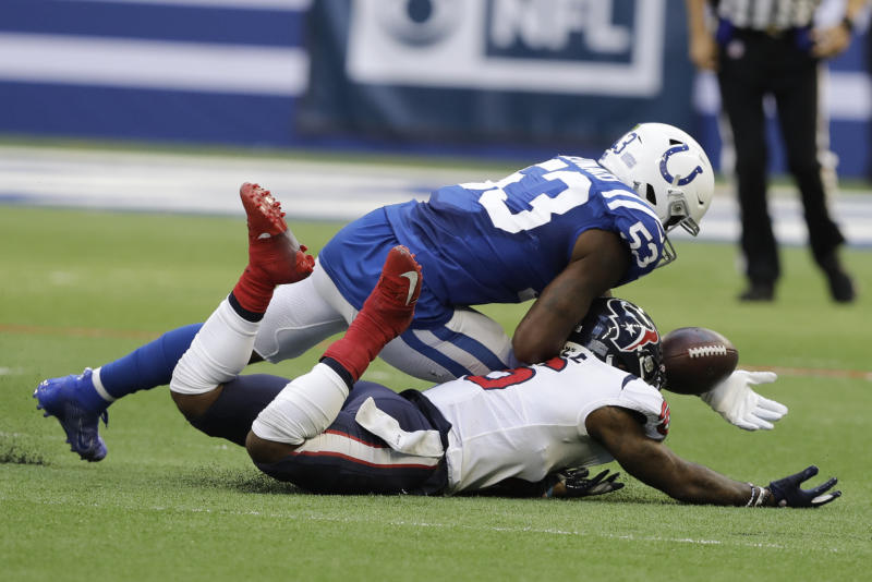 Indianapolis Colts' Darius Leonard (53) intercepts a pass intended for Houston Texans' Keke Coutee (16) during the second half of an NFL football game, Sunday, Oct. 20, 2019, in Indianapolis. (AP Photo/Darron Cummings)