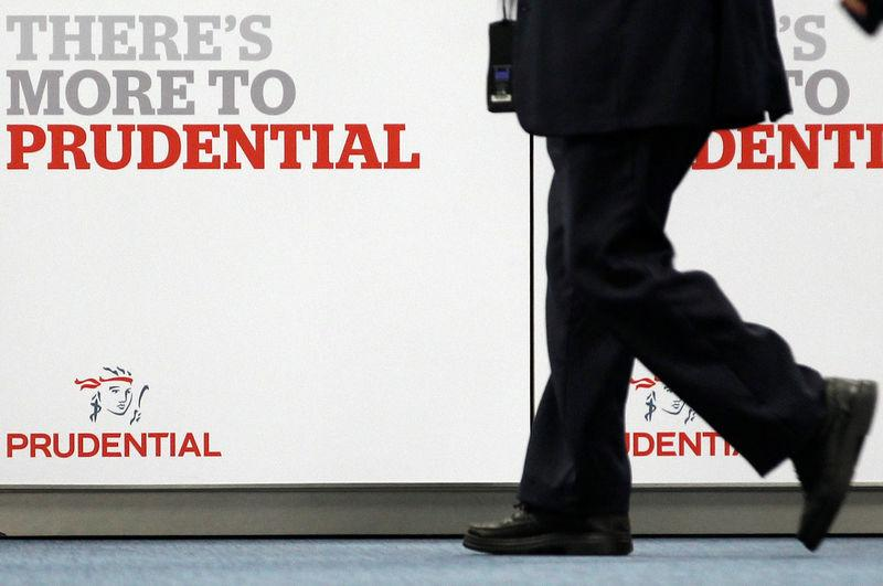 FILE PHOTO: A shareholder arrives at Prudential's annual general meeting in central London
