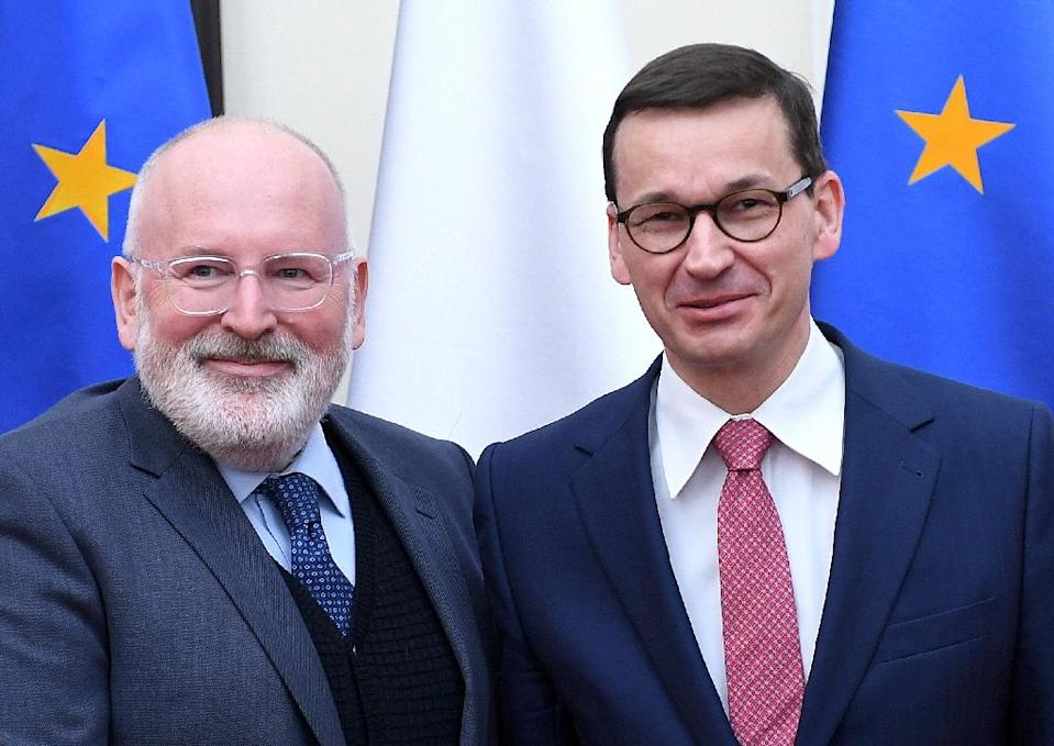 "Vice-President of the European Commission Frans Timmermans (L), pictured on April 9, 2018 with Polish Premier Minister Mateusz Morawiecki, said there was a ""clear willingness"" to solve the festering row between Poland and the EU (AFP Photo/JANEK SKARZYNSKI)"