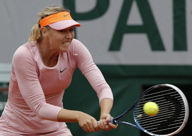 Russia's Maria Sharapova returns the ball to compatriot Ksenia Pervak during their first round match of the French Open tennis tournament at the Roland Garros stadium, in Paris, France, Monday, May 26, 2014. Sharapova won 6-1, 6-2. (AP Photo/Michel Euler)
