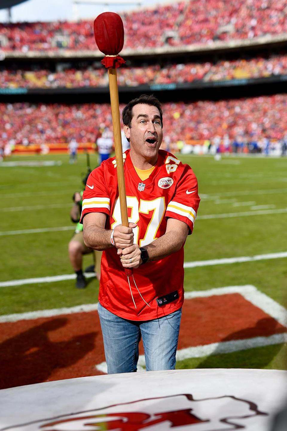 """<p>Rob Riggle's connection to the Chiefs goes back decades: he grew up in Kansas, eventually attending University of Kansas. He and some of the team's other superstar fans (namely, Rudd) <a href=""""https://www.chiefs.com/video/chiefs-kingdom-rudd-and-riggle-act-2-14113130"""" rel=""""nofollow noopener"""" target=""""_blank"""" data-ylk=""""slk:frequently appear in media for the team."""" class=""""link rapid-noclick-resp"""">frequently appear in media for the team.</a></p>"""