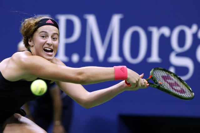 Jelena Ostapenko, of Latvia, returns a shot to Maria Sharapova, of Russia, during the third round of the U.S. Open tennis tournament, Saturday, Sept. 1, 2018, in New York. (AP Photo/Adam Hunger)