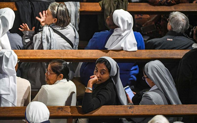 Nuns and worshippers await the arrival of the Pope in Rabat  - AFP