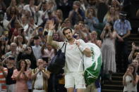 Britain's Andy Murray leaves Centre Court after being defeated by Canada's Denis Shapovalov in the men's singles third round match on day five of the Wimbledon Tennis Championships in London, Friday July 2, 2021. (AP Photo/Kirsty Wigglesworth)