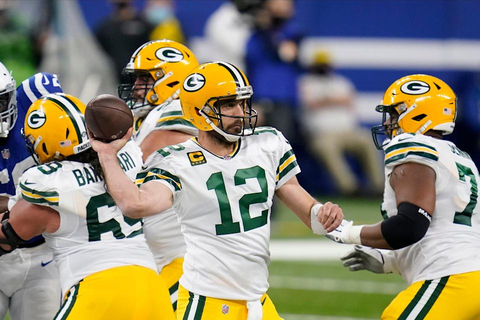 Green Bay Packers quarterback Aaron Rodgers (12) throws during the first half of an NFL football game against the Indianapolis Colts, Sunday, Nov. 22, 2020, in Indianapolis.