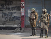 Indian paramilitary soldiers stand guard at a closed market area during a strike called by separatists in Srinagar, Indian controlled Kashmir, Saturday, Oct. 31, 2020. Kashmir's main separatist grouping called the strike to protest new land laws that India enacted on Tuesday, allowing any of its nationals to buy land in the region. Pro-India politicians in Kashmir have also criticized the laws and accused India of putting Kashmir's land up for sale. The move exacerbates concerns of Kashmiris and rights groups who see such measures as a settler-colonial project to change the Muslim-majority region's demography. (AP Photo/Mukhtar Khan)