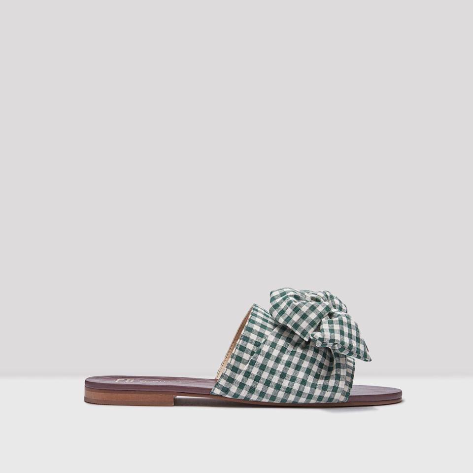"<p><span>Our love for gingham isn't going anywhere fast and these sandals simply scream summer. </span><br><em><a href=""https://miista.com/collections/e8-sandals/products/peggy-dark-green-gingham-sandals"" rel=""nofollow noopener"" target=""_blank"" data-ylk=""slk:Buy here."" class=""link rapid-noclick-resp""><span>Buy here.</span></a></em><br><br></p>"