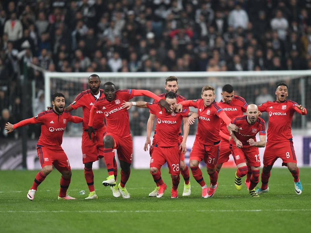 Lyon race to celebrate their dramatic penalty-shootout victory: Getty
