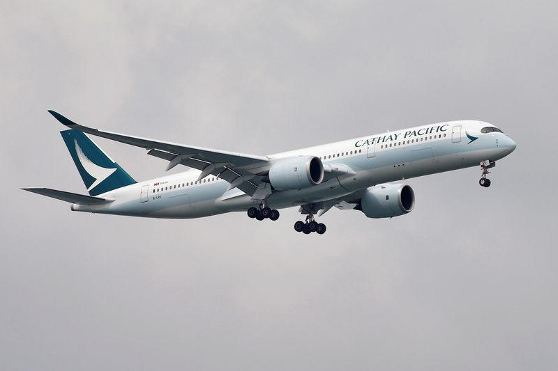 FILE PHOTO: A Cathay Pacific Airways Airbus A350 airplane approaches to land at Changi International Airport in Singapore