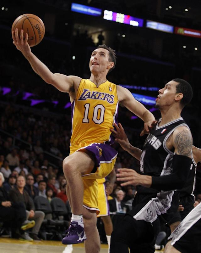 Los Angeles Lakers guard Steve Nash (10) shoots as San Antonio Spurs guard Danny Green, right, defends in the first quarter during an NBA basketball game Friday, Nov. 1, 2013, in Los Angeles. (AP Photo/Alex Gallardo)