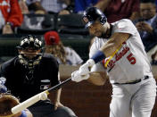 FILE - Then-St. Louis Cardinals' Albert Pujols hits a solo home run during the ninth inning of Game 3 of baseball's World Series against the Texas Rangers in Arlington, Texas, in this Saturday, Oct. 22, 2011, file photo. Pujols has been designated for assignment by the Los Angeles Angels, abruptly ending the 41-year-old superstar slugger's decade with his second major league team. The Angels announced the move Thursday, May 6, 2021, a day after Pujols wasn't in their lineup for their fourth consecutive loss. (AP Photo/Eric Gay, File)