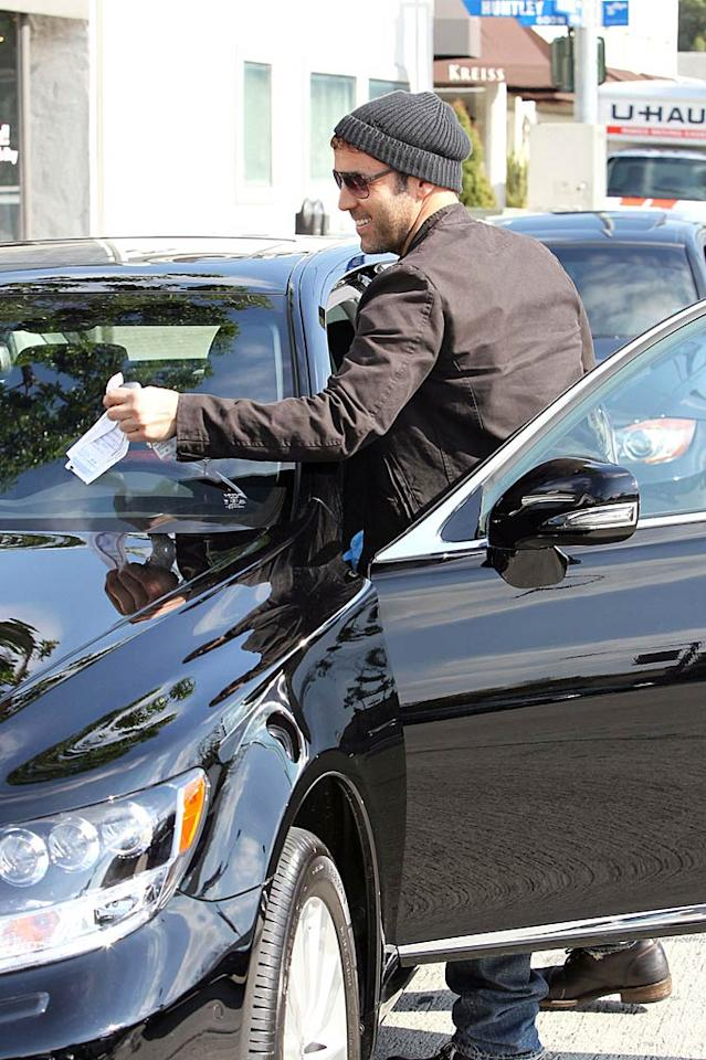 """Even stars aren't immune to the mundane stuff the rest of us have to deal with. Returning to his car, Piven found a parking ticket waiting for him. Never fear, we're sure, there's lots of """"Entourage"""" dollars in the bank to cover that small infraction! Brabus/<a href=""""http://www.pacificcoastnews.com/"""" target=""""new"""">PacificCoastNews.com</a> - February 1, 2011"""