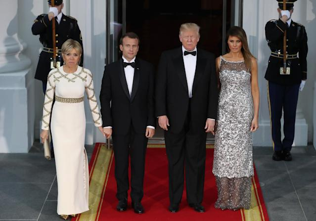 Melania Trump, pictured with President Trump and French first couple Emmanuel and Brigitte Macron, attended the administration's first dinner wearing Chanel. (Photo: Getty Images)