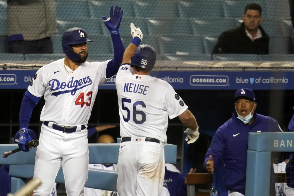 Los Angeles Dodgers' Sheldon Neuse (56) celebrates his solo home run with Edwin Rios (43) during the seventh inning of the team's baseball game against the San Diego Padres on Thursday, April 22, 2021, in Los Angeles. (AP Photo/Marcio Jose Sanchez)