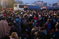 French gendarmes evacuate makeshift migrant camp in the outskirts of Paris