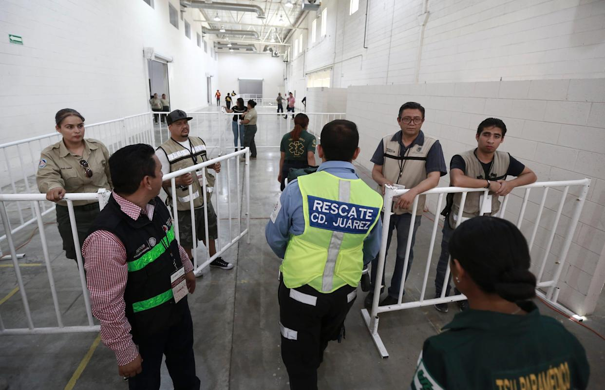Mexican government workers at newly opened migrant shelter, formerly an assembly plant, in Ciudad Juarez on Aug. 1, 2019.