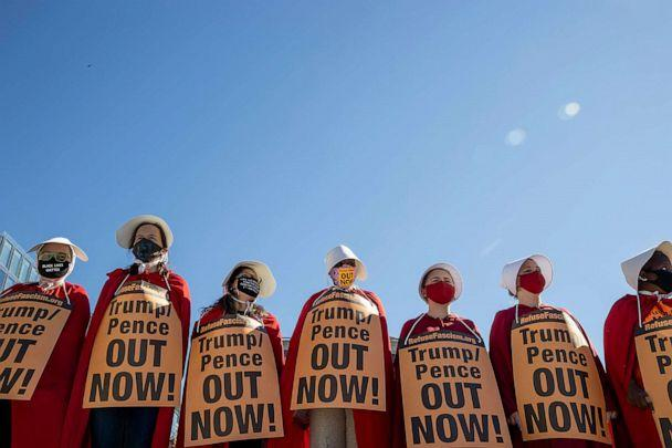 PHOTO: Dressed as handmaids, protesters attend the Women's March at Freedom Plaza on Oct. 17, 2020, in Washington. (Tasos Katopodis/Getty Images)