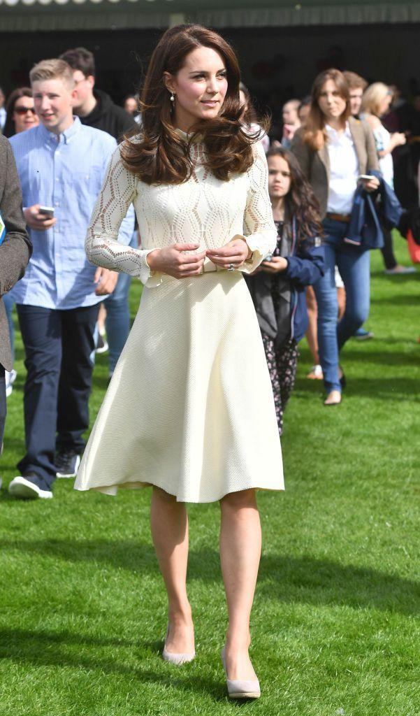 <p>The Duchess of Cambridge made an appearance at a garden tea party hosted by Buckingham Palace; the event recognized young lives lost while serving the armed forces. She wore a polished, ivory dress from See by Chloé. The lace top had a ruffled neckline and ruffled sleeves, and the Duchess brought it together with the skirt with an Acne Studios belt. </p>
