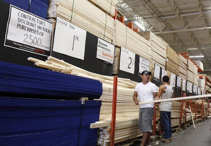 People shop for lumber at a Home Depot store in New York