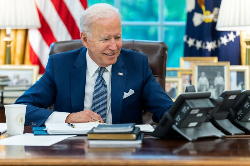 U.S. President Joe Biden speaks by phone with French President Macron from the White House in Washington