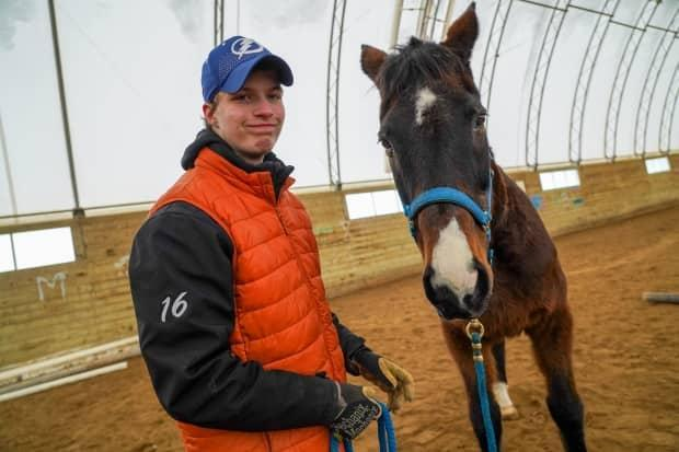 Alex, 15, is a client of an equine learning program at Kindred Horse Rescue in North Gower. 'I feel relaxed whenever I'm with Nan. I feel safe, and she feels safe with me.'