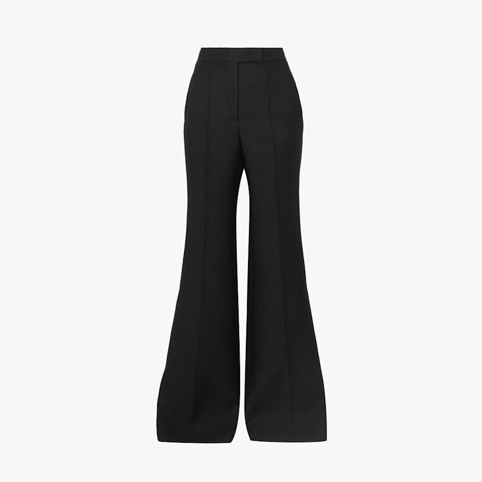 "$1990, NET-A-PORTER. <a href=""https://www.net-a-porter.com/en-us/shop/product/gabriela-hearst/leda-wool-cady-flared-pants/1278444?cm_mmc=Google-ProductSearch-US--c-_-NAP_EN_US_PLA-_-NAP%C2%A0-%C2%A0US%C2%A0-%C2%A0GS%C2%A0-+Designer+-+Clothing%C2%A0-+Pants%C2%A0-%C2%A0Medium--Pants+-+Flared_AM&gclid=CjwKCAjw6fCCBhBNEiwAem5SOwz_MnV-SkXolkvGVEnd6mqyWsSveg9j9RGD_jZvIHuP9C5DcRYu7RoCMqwQAvD_BwE&gclsrc=aw.ds"" rel=""nofollow noopener"" target=""_blank"" data-ylk=""slk:Get it now!"" class=""link rapid-noclick-resp"">Get it now!</a>"