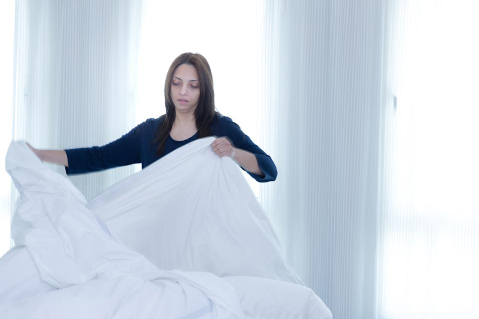 Changing the duvet cover is one of the worst chores. (posed by model, Getty Images)