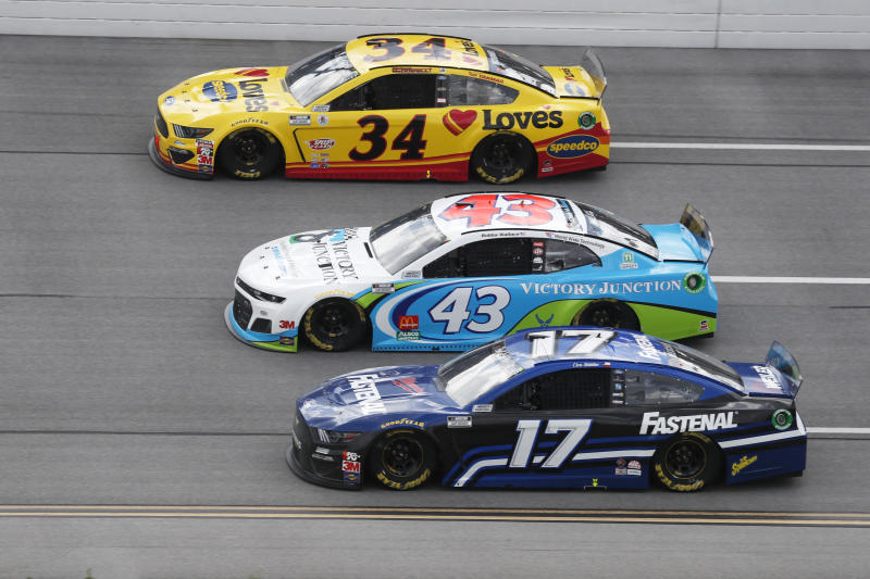 Michael McDowell (34), Bubba Wallace (43) and Chris Buescher (17) ride side-by-side during a NASCAR Cup Series auto race at Talladega Superspeedway in Talladega Ala., Monday, June 22, 2020. (AP Photo/John Bazemore)