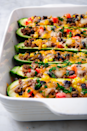 "<p>These are unbelievably colorful—and delicious.</p><p>Get the recipe from <a href=""https://www.delish.com/cooking/recipe-ideas/a19757076/burrito-zucchini-boats-recipe/"" rel=""nofollow noopener"" target=""_blank"" data-ylk=""slk:Delish."" class=""link rapid-noclick-resp"">Delish.</a></p>"