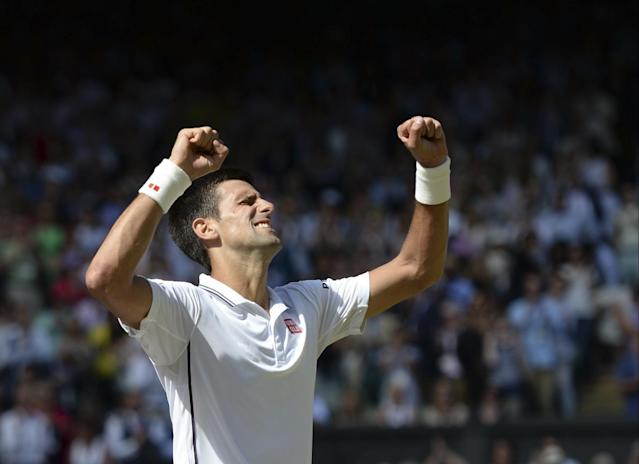 Novak Djokovic of Serbia celebrates after defeating Grigor Dimitrov of Bulgaria during their men's singles semifinal match at the All England Lawn Tennis Championships at Wimbledon, London, Friday, July, 4, 2014. (AP Photo/Anthony Devlin, Pool)