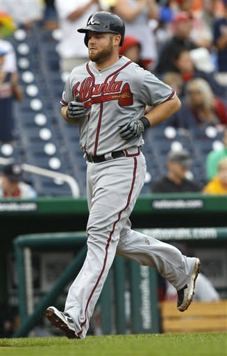 Atlanta Braves Brian McCann heads home after hitting a solo home run during the second inning in the first baseball game of a doubleheader against the Washington Nationals, Saturday, July 21, 2012, in Washington. (AP Photo/Carolyn Kaster)