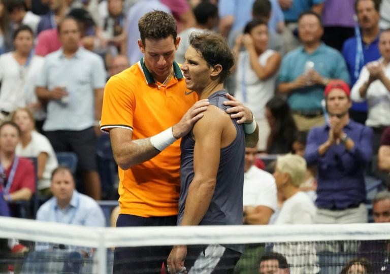 Gentle giant: Juan Martin del Potro consoles Rafael Nadal after the Spaniard retires from their US Open semi-final