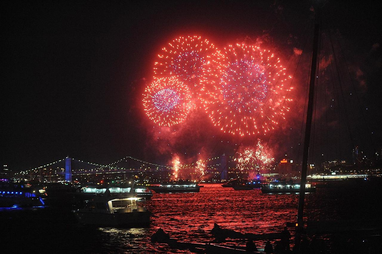 The Macy's Fourth of July Fireworks are seen from a Circle Line cruise ship, Friday, July 4, 2014, in New York. (Photo by Brad Barket ]/Invision /AP)